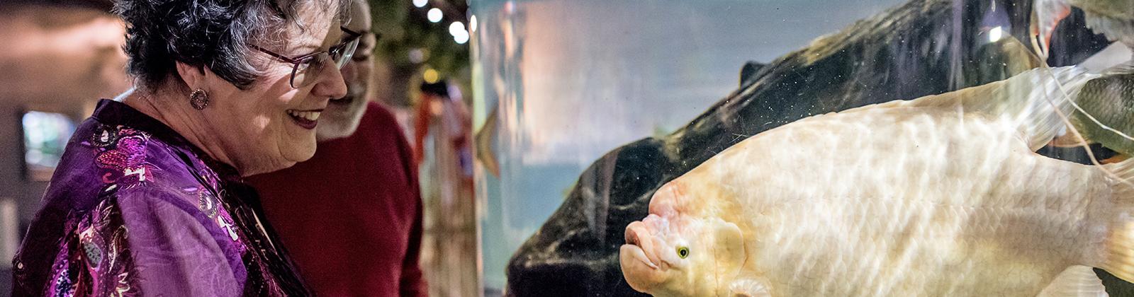 woman smiling at fish
