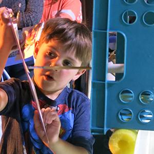 child making stingray art